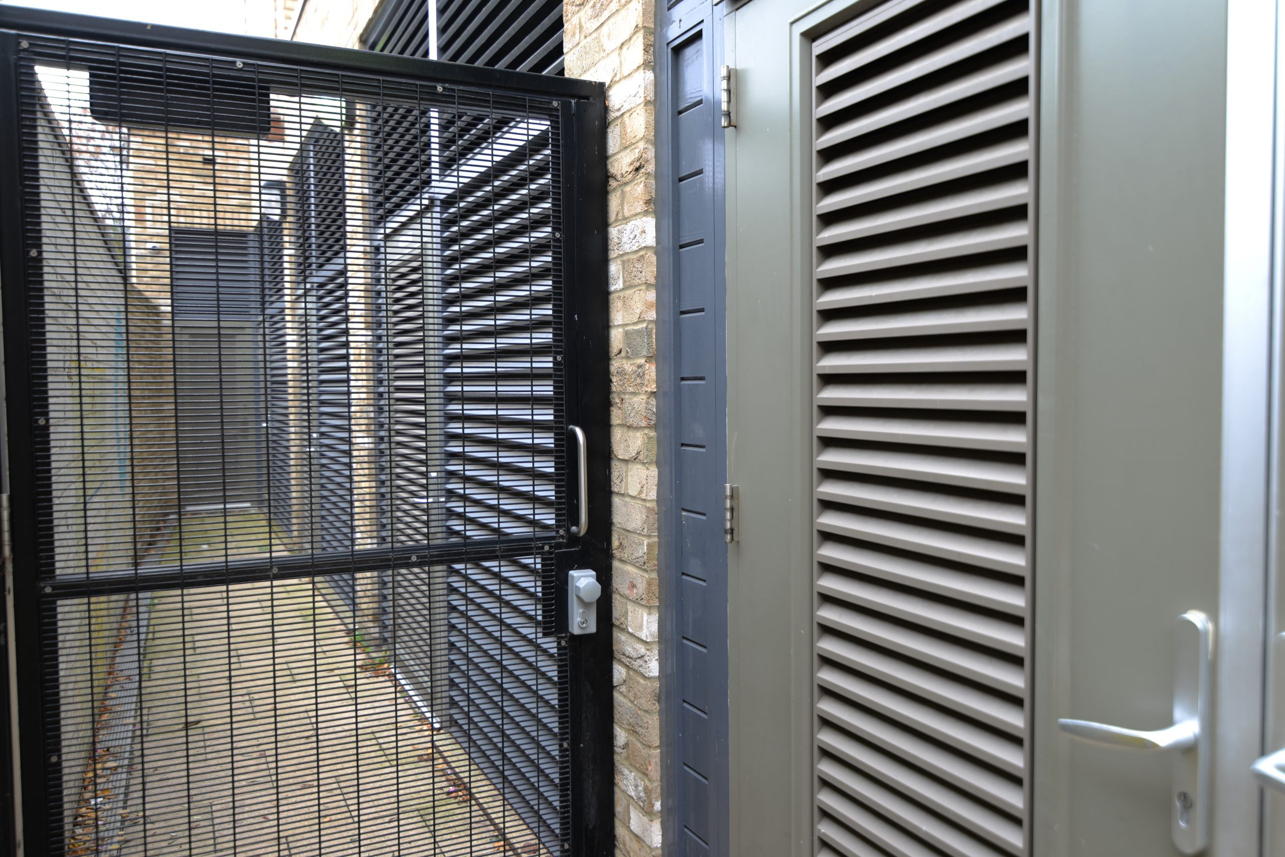 INDUSTRIAL STEEL LOUVERED DOORS AND GATES FABRICATED TO LPS1175 SR2 AND PAS24 STANDARD. PRODUCED AND INSTALLED BY PREMIER SECURITY CONSULTANTS LTD.