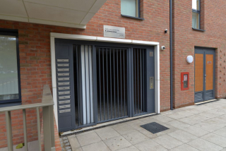 INDUSTRIAL STEEL GATES AND INTEGRATED MAIL BOX SYSTEM FABRICATED TO LPS1175 SR2 AND PAS24 STANDARD. PRODUCED AND INSTALLED BY PREMIER SECURITY CONSULTANTS LTD.