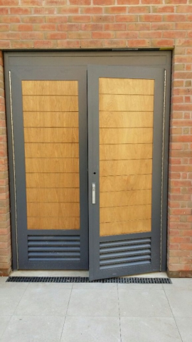 INDUSTRIAL STEEL DOUBLE DOOR WITH WOOD FACIA FABRICATED TO LPS1175 SR2 AND PAS24 STANDARD. PRODUCED AND INSTALLED BY PREMIER SECURITY CONSULTANTS LTD.