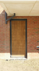 INDUSTRIAL STEEL SINGLE DOOR WITH WOOD FACIA FABRICATED TO LPS1175 SR2 AND PAS24 STANDARD. PRODUCED AND INSTALLED BY PREMIER SECURITY CONSULTANTS LTD.