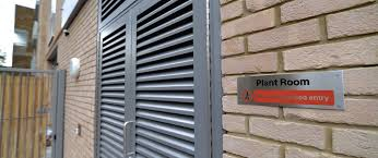 INDUSTRIAL STEEL LOUVERED PLANT ROOM DOORS FABRICATED TO LPS1175 SR2 AND PAS24 STANDARD. PRODUCED AND INSTALLED BY PREMIER SECURITY CONSULTANTS LTD.