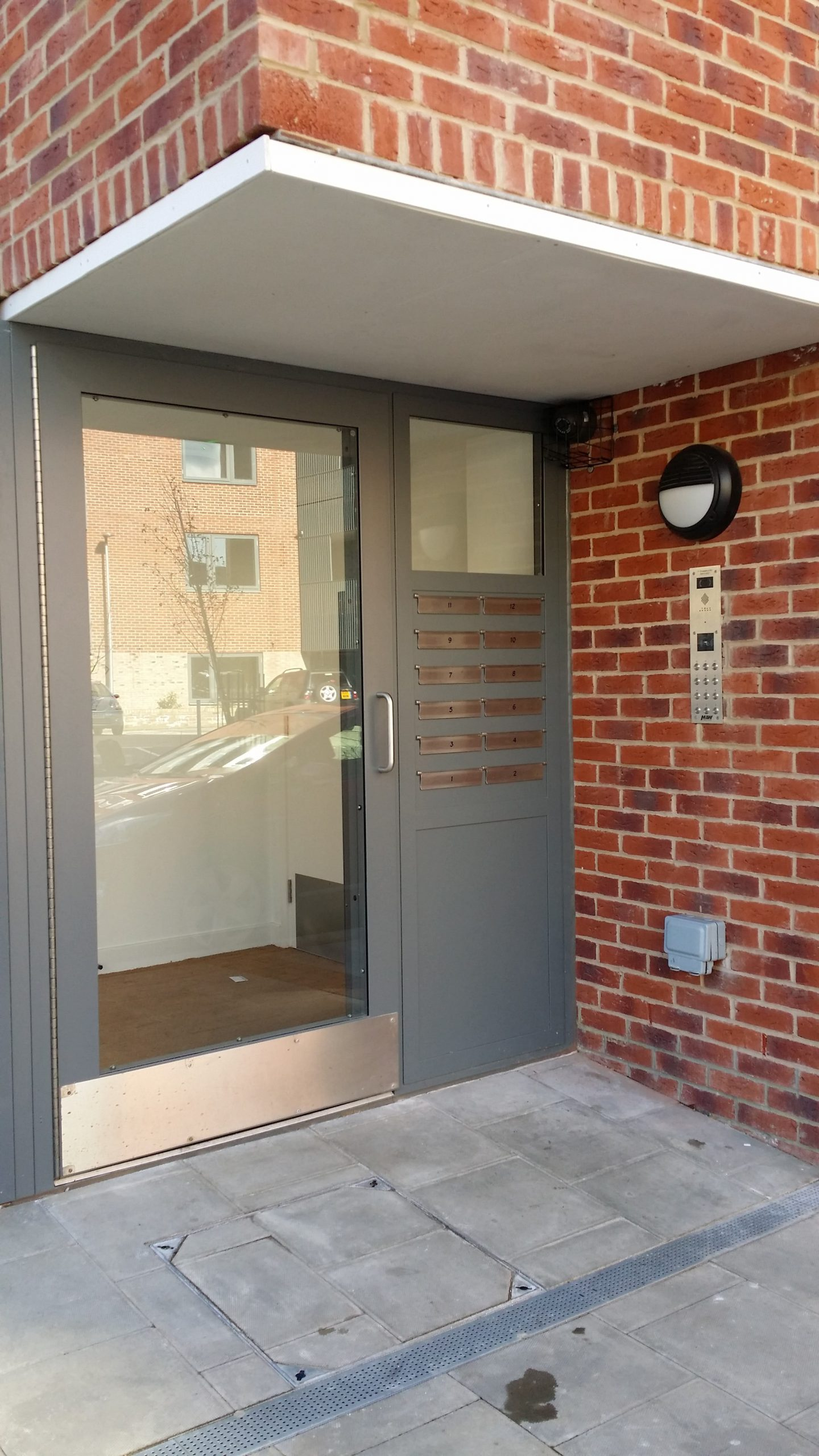 INTEGRATED COMMUNAL STEEL SECURITY MAILBOX SYSTEM WITH SECURED BY DESIGN CERTIFICATION.