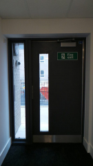 INDUSTRIAL FIRE EXIT STEEL DOORS FABRICATED TO LPS1175 SR2 AND PAS24 STANDARD. PRODUCED AND INSTALLED BY PREMIER SECURITY CONSULTANTS LTD.
