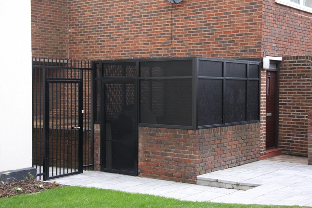 STEEL GATES COMMUNAL BIN STORAGE AREA FABRICATED AND INSTALLED BY PREMIER SECURITY CONSULTANTS THE HOME OF SECURED BY DESIGN