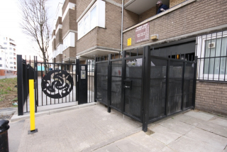 STEEL FENCED BIN STORAGE AREA AND DECORATIVE STEEL GATE FABRICATED AND INSTALLED BY PREMIER SECURITY CONSULTANTS THE HOME OF SECURED BY DESIGN