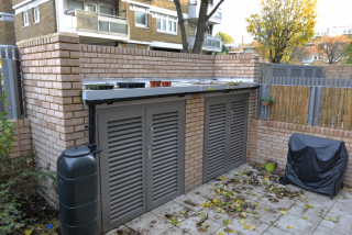 GATED BIN STORAGE FABRICATED IN STEEL AND INSTALLED BY PREMIER SECURITY CONSULTANTS THE HOME OF SECURED BY DESIGN