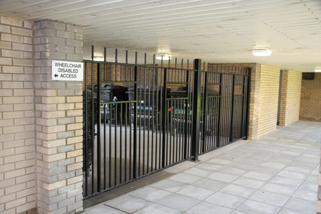 METAL GATED BIN STORAGE FABRICATED AND INSTALLED BY PREMIER SECURITY CONSULTANTS THE HOME OF SECURED BY DESIGN
