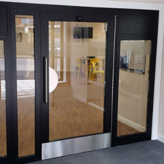 INTEGRAL LPS1175 SR2 60-MINUTE FIRE-RATED DOOR AND SIDE PANELS. SECURED BY DESIGN