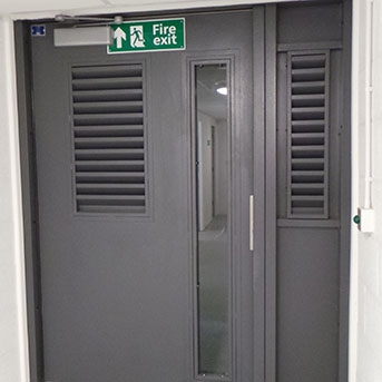FIRE EXIT PAS24 STEEL DOOR WITH LOUVRE SECTION AND PANEL. SBD LPS1175 SR2