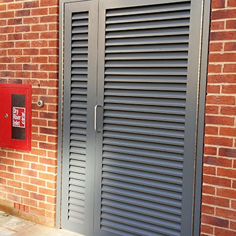 PAS24 STEEL LOUVRE DOOR WITH SIDE PANEL. SECURED BY DESIGN.LPS1173 SR2
